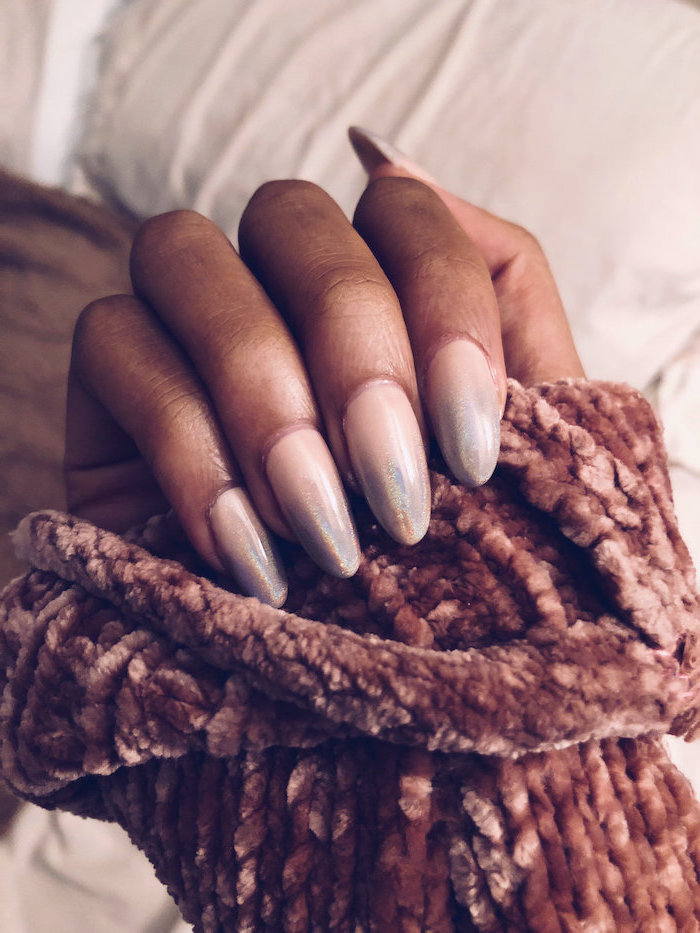 nude to metallic silver gradient nail polish, ombre coffin nails, long almond nails, hand covered with knitted velvet sleeve