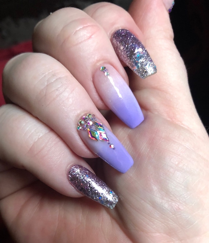 nude to purple gradient nail polish, ombre nail designs, purple glitter nail polish on index and pinky, rhinestones decorations