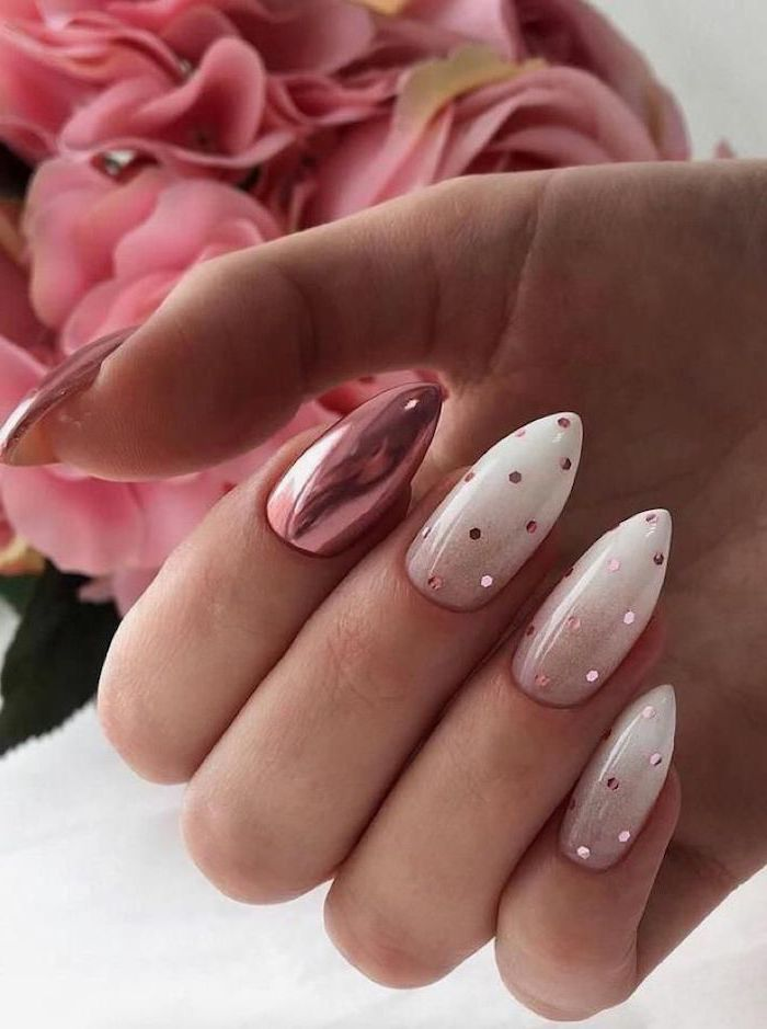 nude to white gradient nail polish, metallic rose gold nail polish on thumb and ring finger, red ombre nails, rose gold decorations
