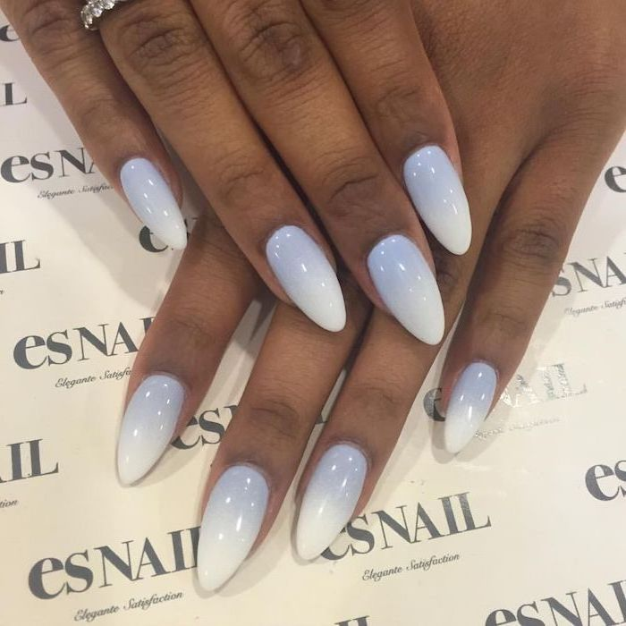 icy blue to white gradient nail polish, red ombre nails, long almond nails, hands placed on white surface