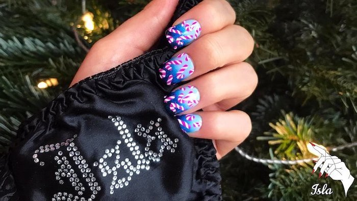 blue ombre nail polish, candy cane decorations on each nail, popular nail colors, medium length square nails