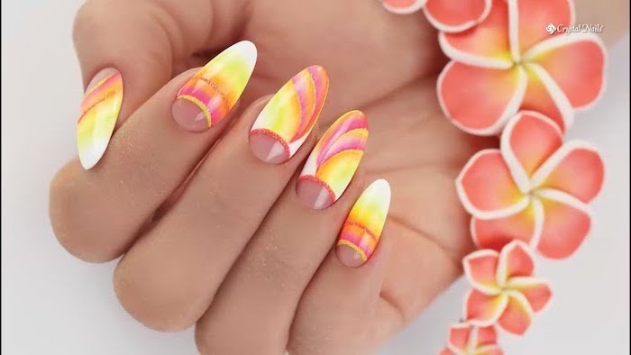 floral motif on long almond nails, blue ombre nails, pink to orange yellow and white gradient nail polish