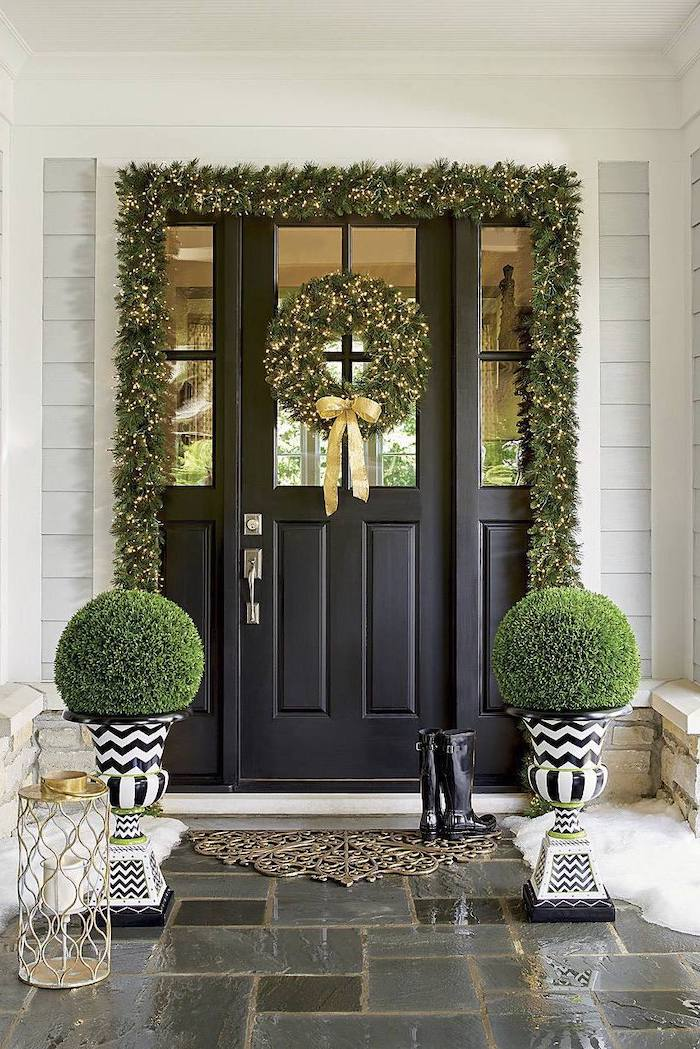 wreaths with lights, hanging over door and door frame, grinch outdoor christmas decorations, bushes on both sides