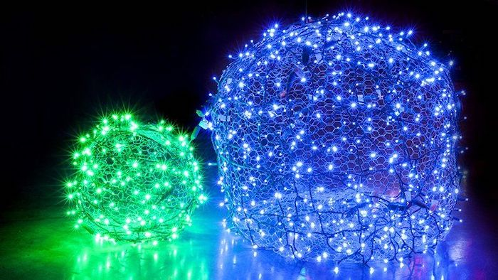 green and blue lights, intertwined in baubles, made of chicken wire, outdoor christmas decorations