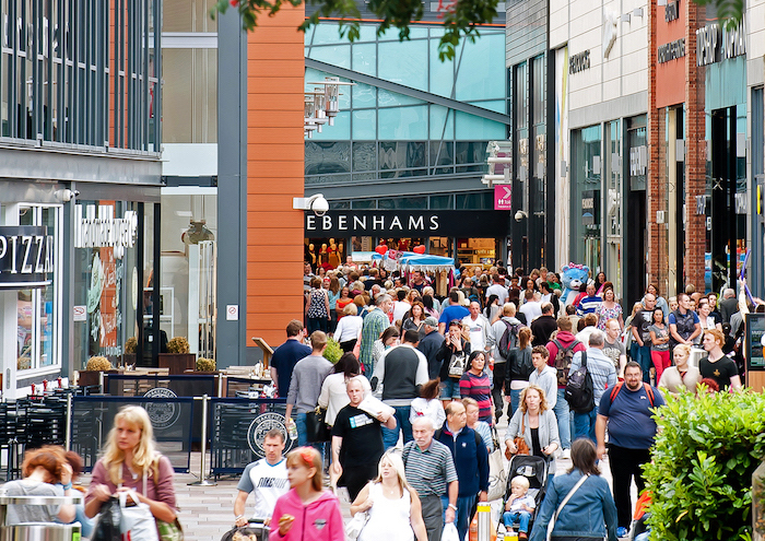 people walking up and down the street, benefits of shopping, high street, shops on both sides