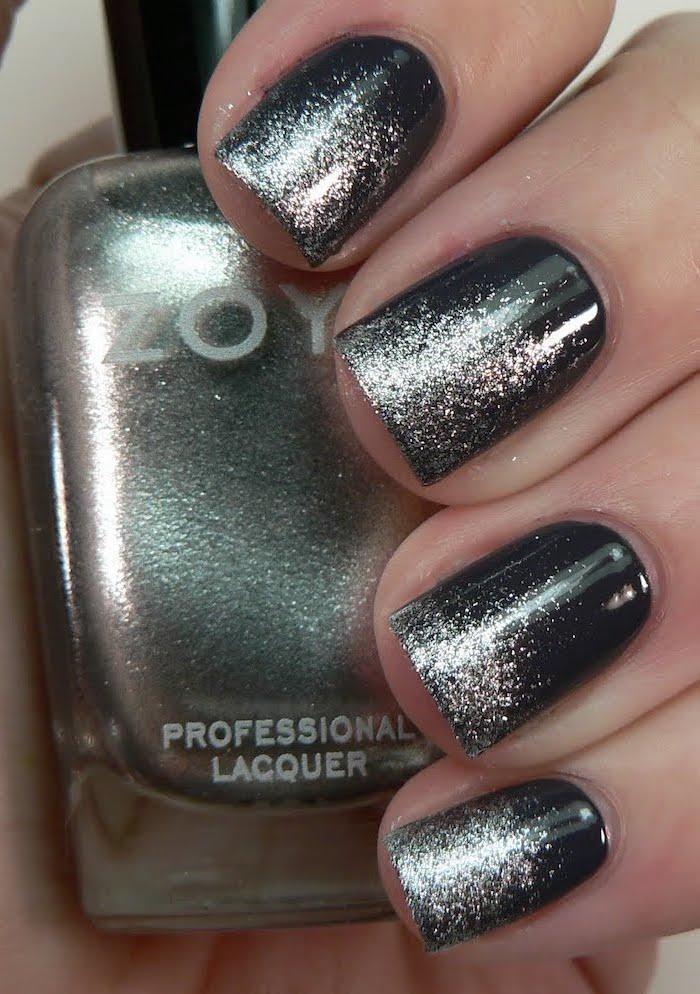 black to gold glitter gradient nail polish, short square nails, blue ombre nails, hand holding a nail polish bottle