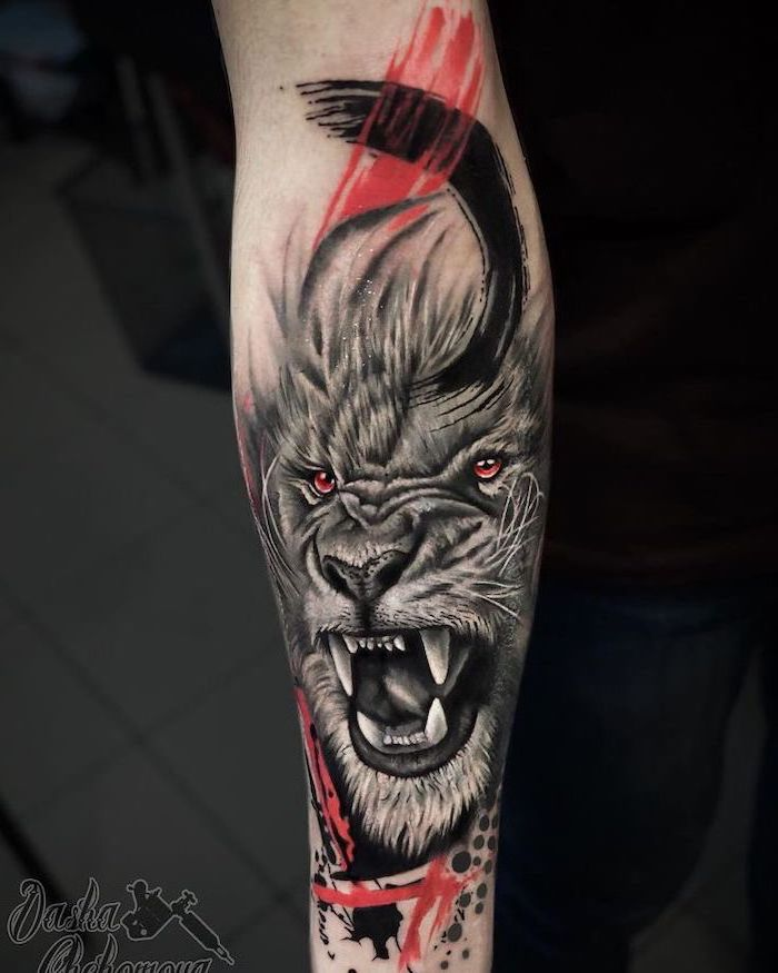 trash polka tattoo, tribal lion tattoo, forearm tattoo, roaring lion with red and black brush strokes around it