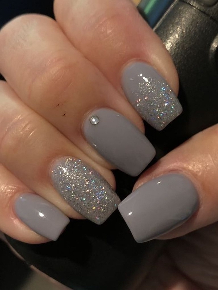 grey nail polish, silver glitter on index and ring finger, popular nail colors, medium length squoval nails