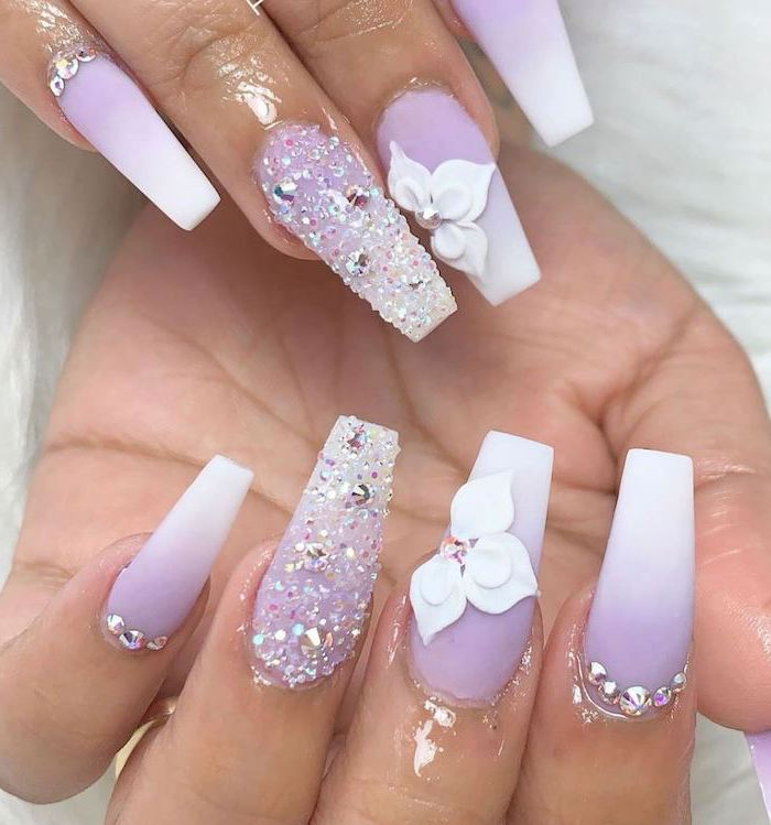 purple to white gradient matte nail polish, rhinestones and decorations on each nail, french fade nails, long coffin nails