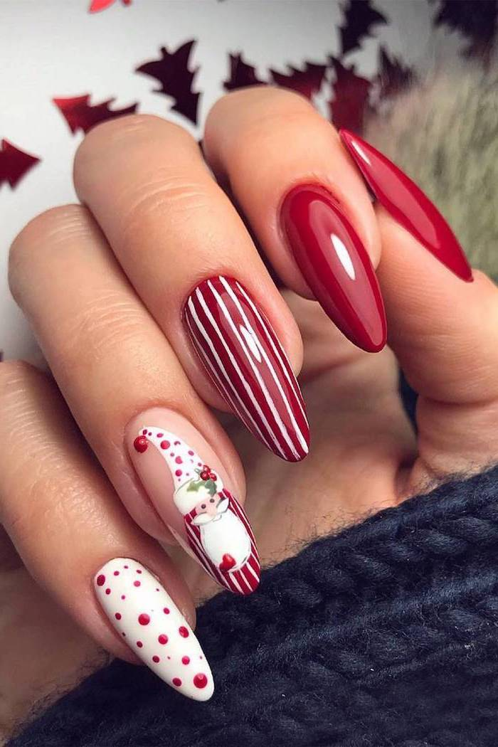 red and white nail polish on long nails, nude nail designs, santa decoration on ring finger