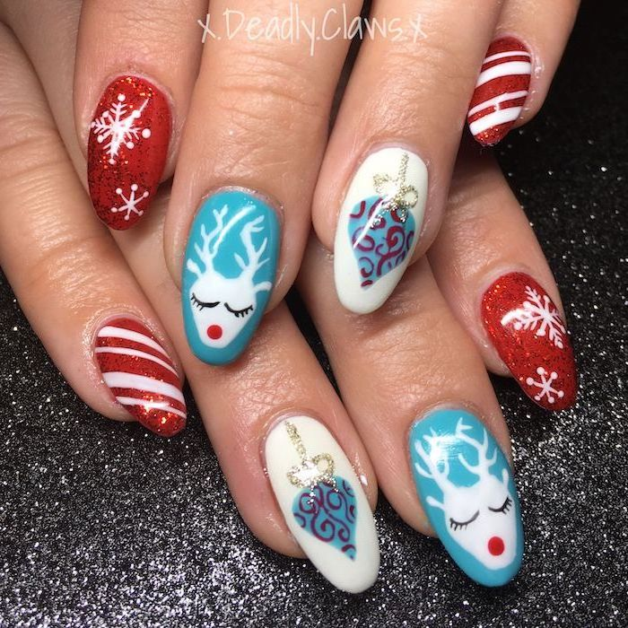 almond shaped nails, red white and blue nail polish, trending nail colors, different christmas themed decorations on each finger