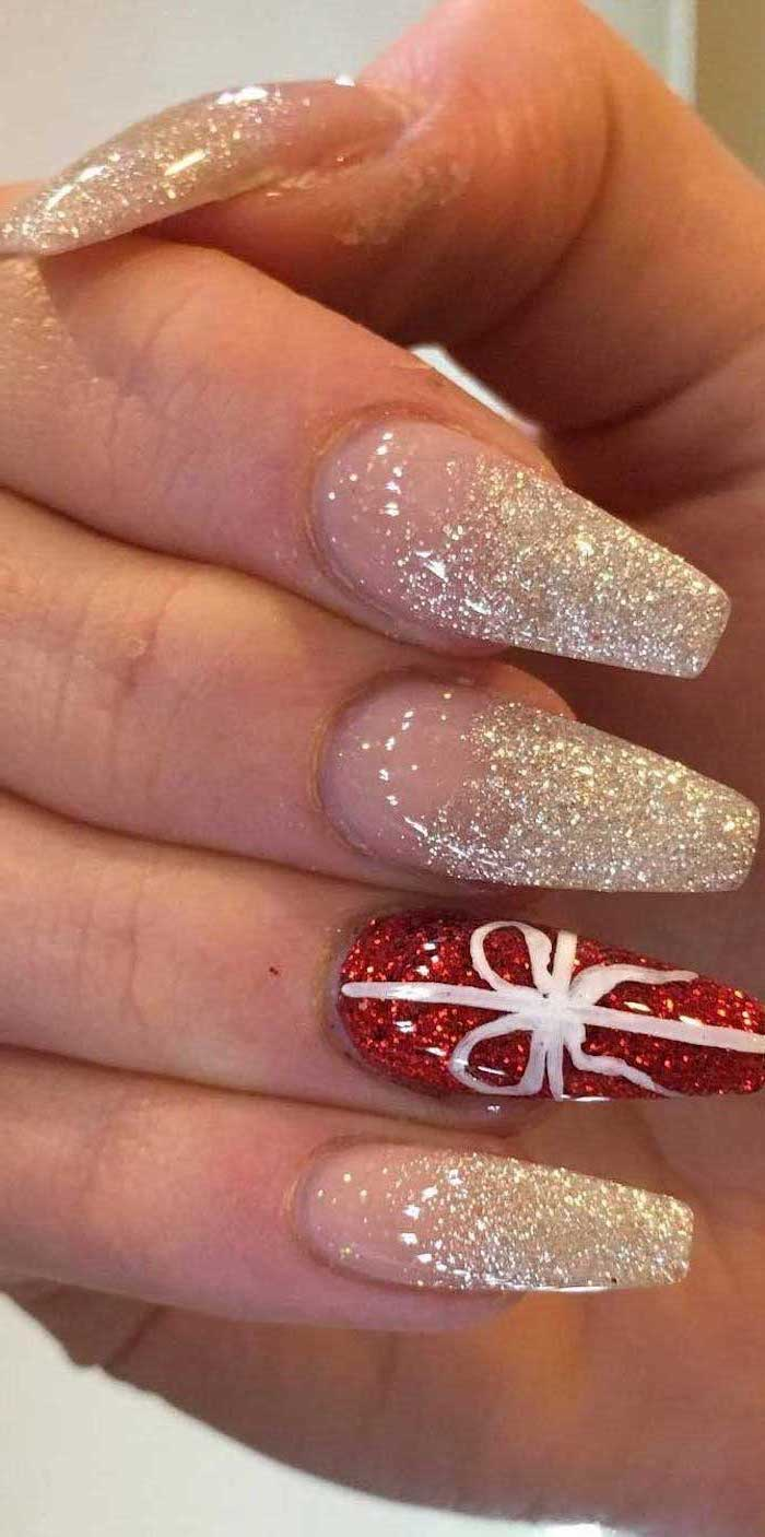 gold and red glitter nail polish, trending nail colors, long coffin nails, white bow decoration on the ring finger