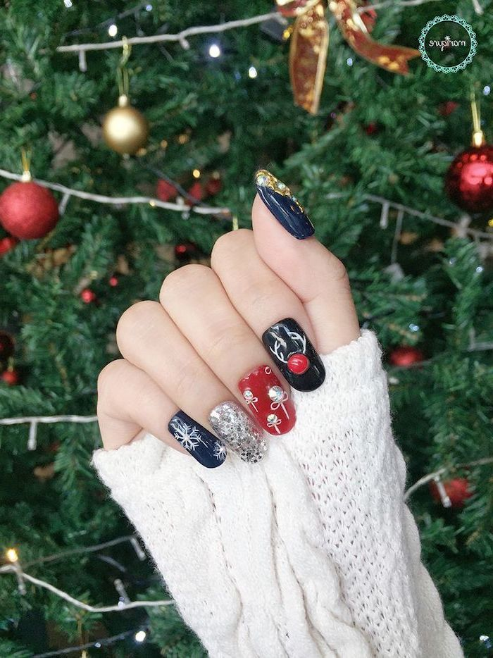 dark blue green and red nail polish, trending nail colors, silver glitter, different christmas themed rhinestone decorations