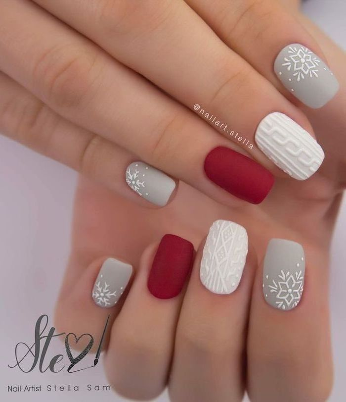 christmas nail colors, grey white and red matte nail polish, decorations on the middle index and pinky fingers