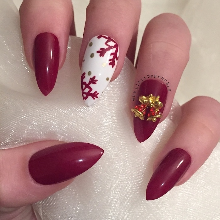 red and white nail polish, nude nail designs, snowflakes decoration on middle finger, gold rhinestone bells on ring finger