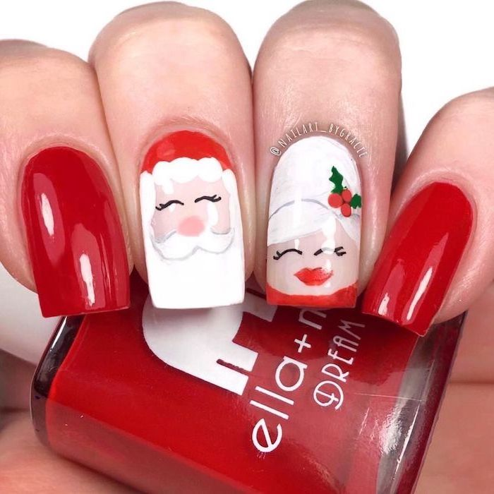 red and white nail polish, santa claus and mrs claus decorations on the middle and ring finger, christmas nail colors