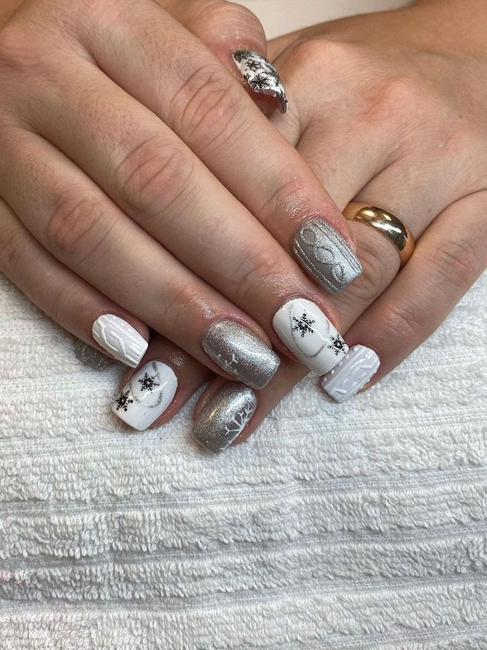 white and silver metallic nail polish, winter nail ideas, short square nails, different decorations on each nail