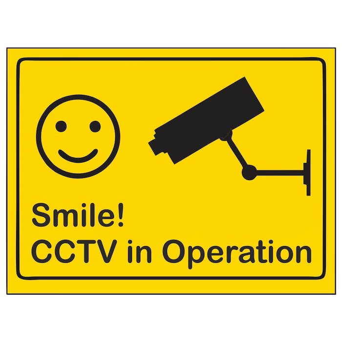 smile cctv in operation sign, target for burglars, smiley face and camera on yellow background