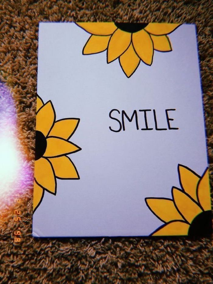 smile written in black on white background, surrounded by yellow sunflowers, cute drawing ideas