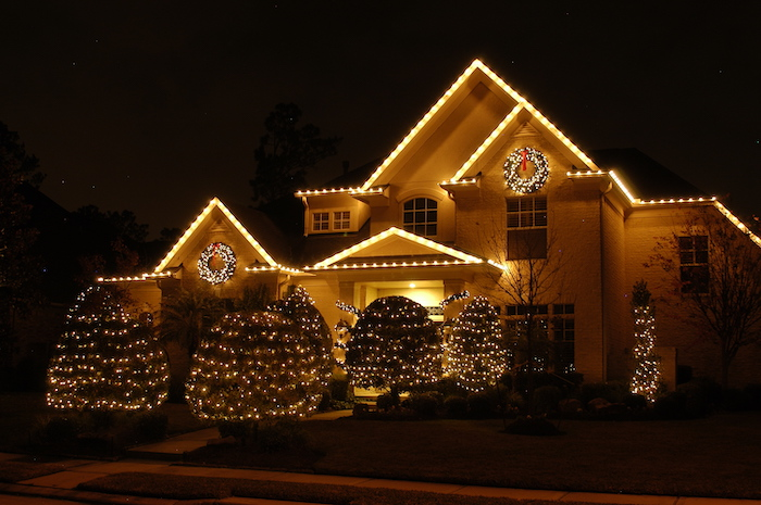 large two storey house, decorated with lights, outside christmas decoration ideas, all the bushes in the yard, decorated with lights