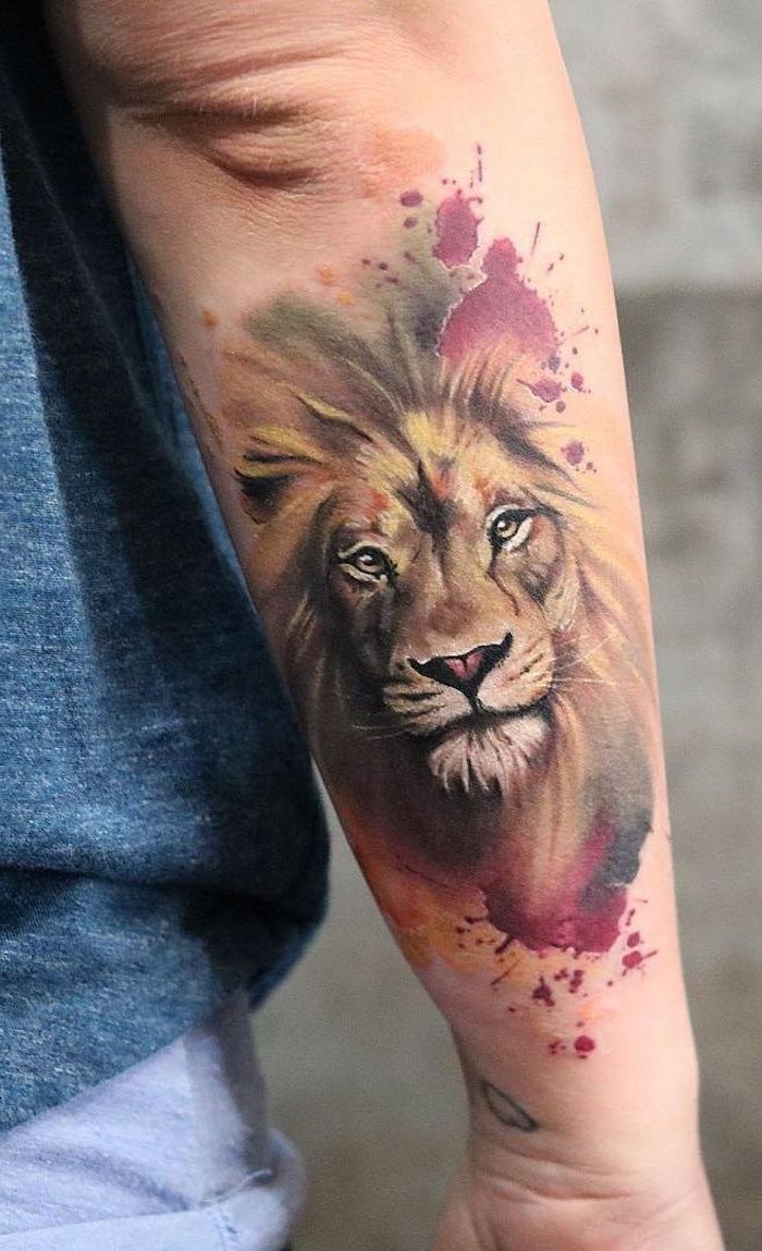 small lion tattoo, watercolor tattoo, back of arm tattoo, lion head, surrounded by watercolor in pink yellow and red