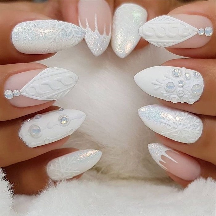 white matte and glitter nail polish, january nail colors, different decorations with rhinestones on each finger
