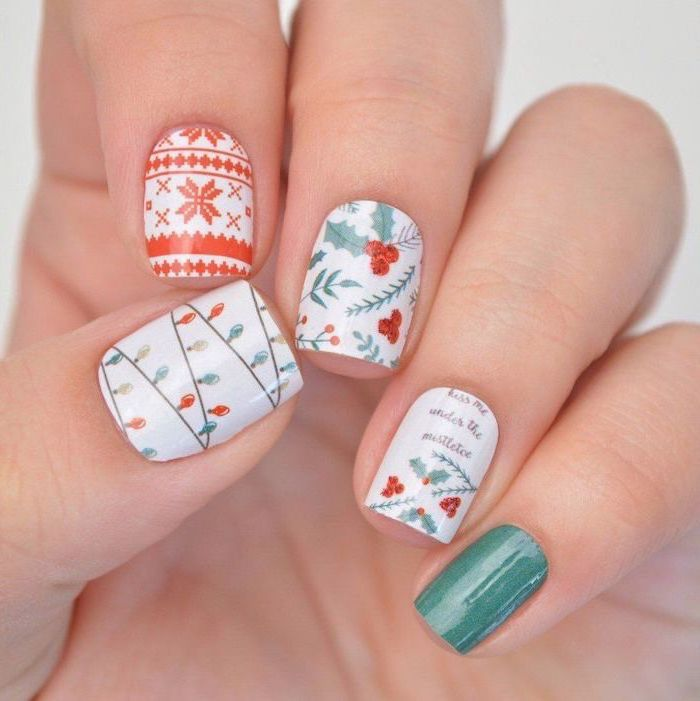 white red and green nail polish, short nails with different, christmas themed decorations on each nail, january nail colors