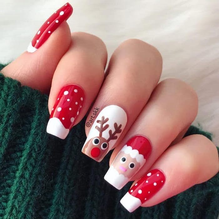 red and white nail polish, santa and reindeer decorations on middle and ring fingers, winter acrylic nails, long square nails