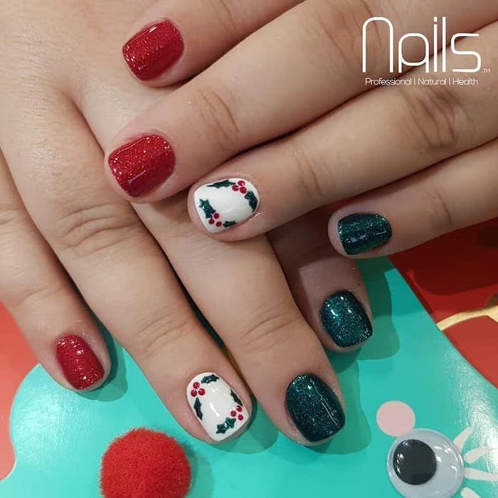 red and dark green glitter nail polish, winter acrylic nails, mistletoe decorations on the ring fingers