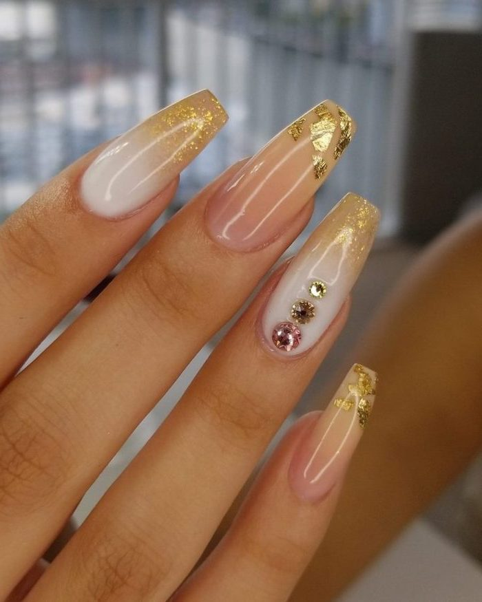 glitter ombre nails, long coffin nails, white to gold glitter gradient nail polish, rhinestones decorations on the ring finger
