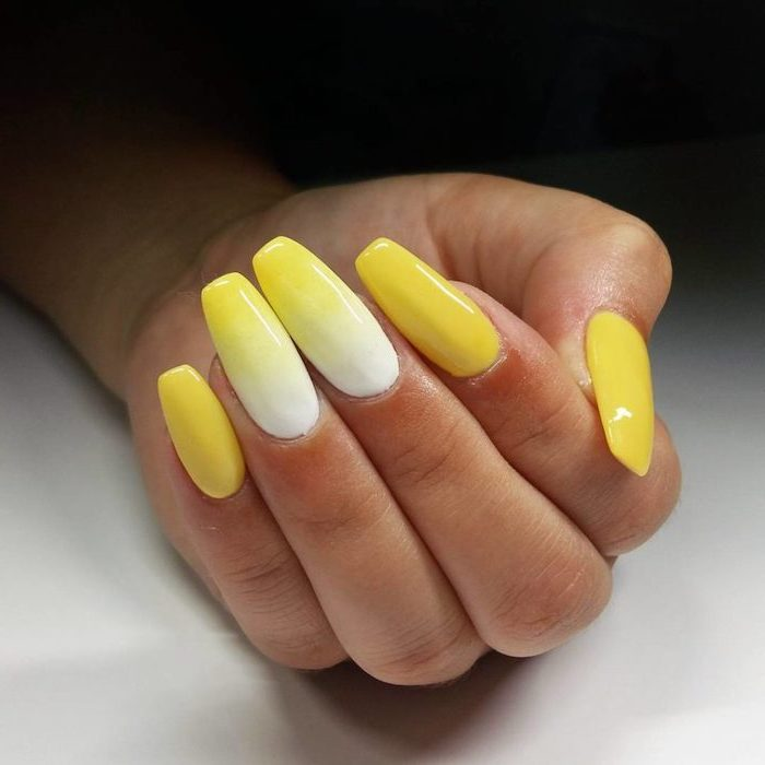 white to yellow gradient nail polish, on middle and ring fingers, how to do ombre nails, yellow nail polish on the rest of the fingers