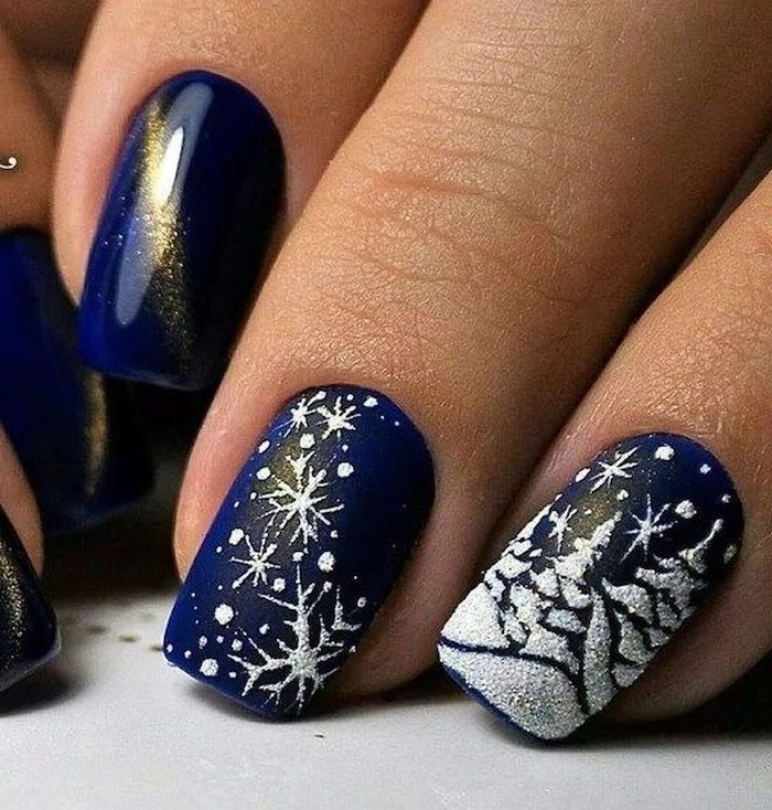 blue metallic nail polish, cute winter nails, white christmas themed decorations on middle and ring fingers