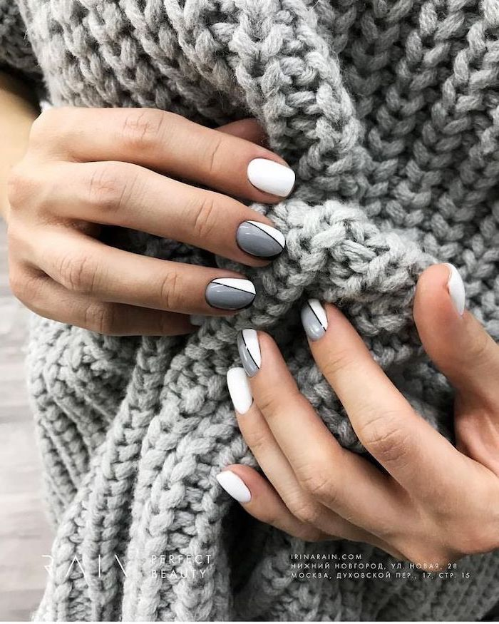 grey and white nail polish, geometric decorations on each finger, cute winter nails, short squoval nails