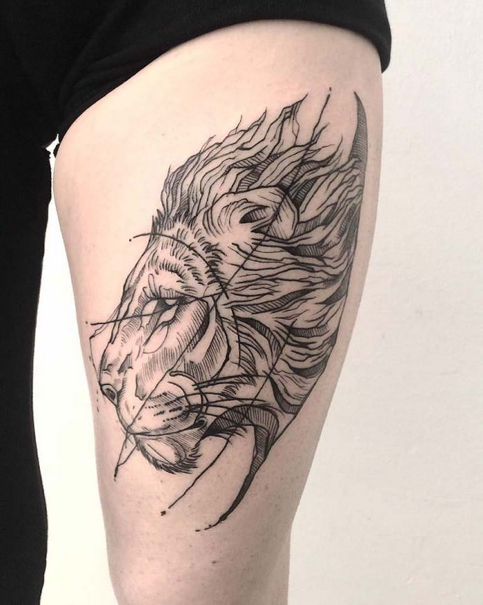 profile of a lion head with large mane, small lion tattoo, thigh tattoo on woman wearing black sweatpants