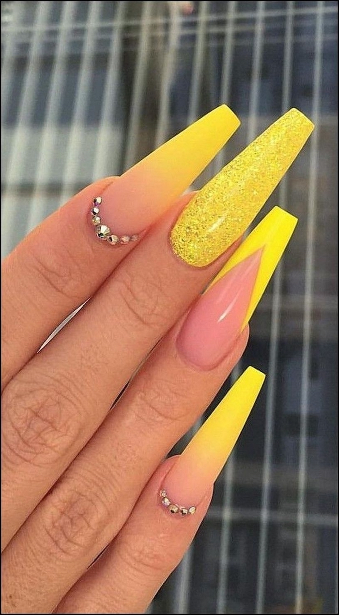 nude to yellow gradient matte nail polish, rhinestones decorations, yellow glitter, how to do ombre nails, extra long coffin nails