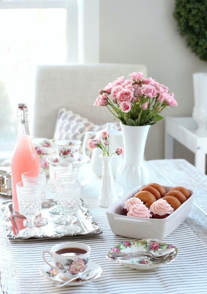 afternoon tea table arrangement, valentines day decor, vintage tea cups, mimosa in a bottle with glasses on silver tray