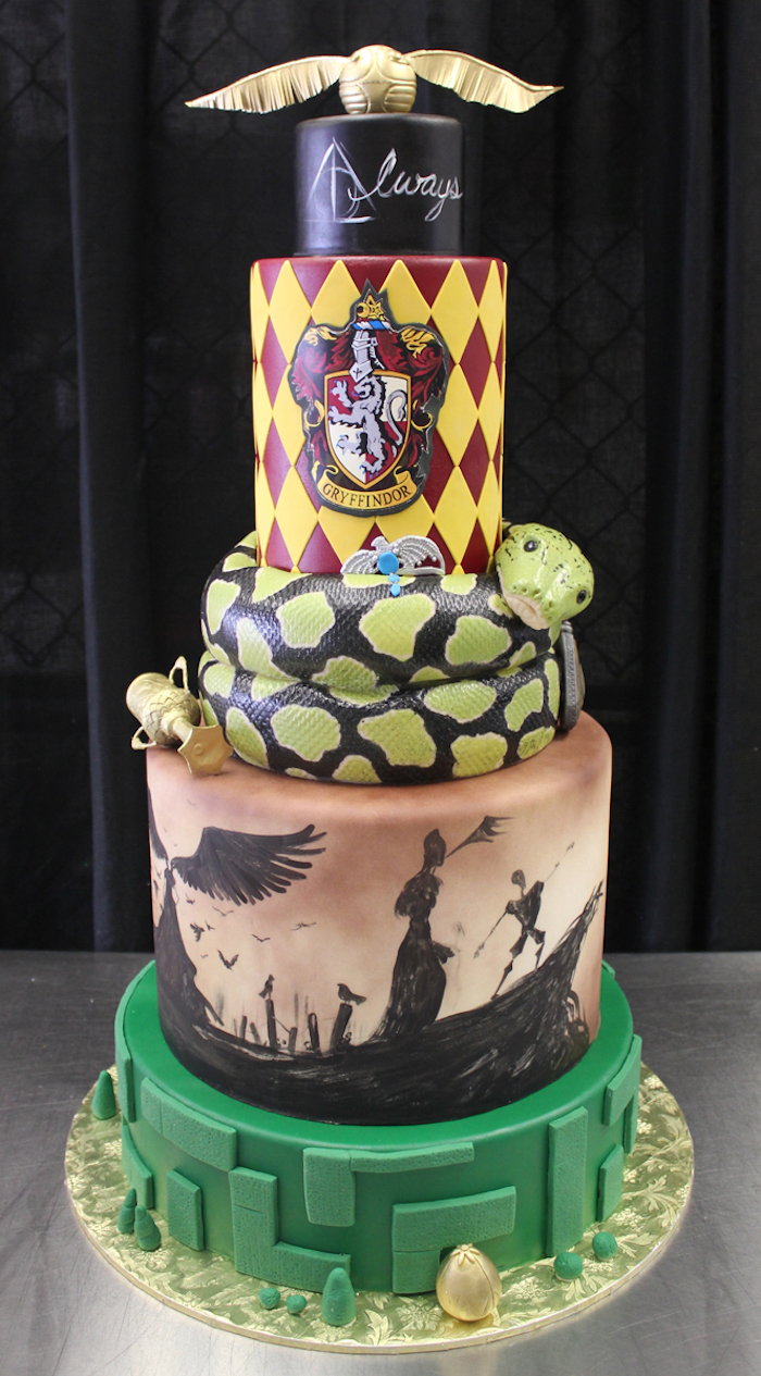 five tier cake, harry potter cake, nagini tier below the gryffindor tier, deathly hallows inspired tier with the story of three brothers illustrations