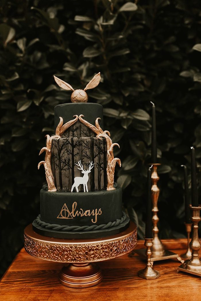 three tier cake, covered with dark green fondant, golden snitch on top, harry potter cake ideas, stag patronus on the middle tier