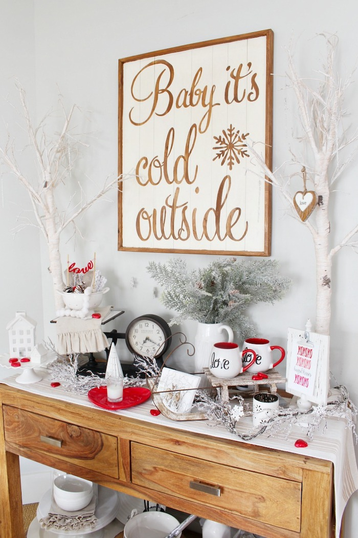 baby it's cold outside wooden sign, valentine decorations, wooden shelf with different decorations on it, love coffee mugs