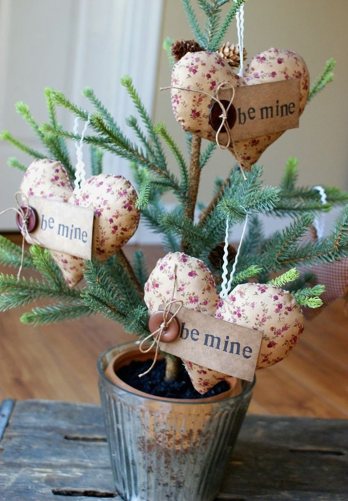 fabric hearts with wooden be mine signs, valentine decorations ideas, hanging on tree branch, planted in a metal pot