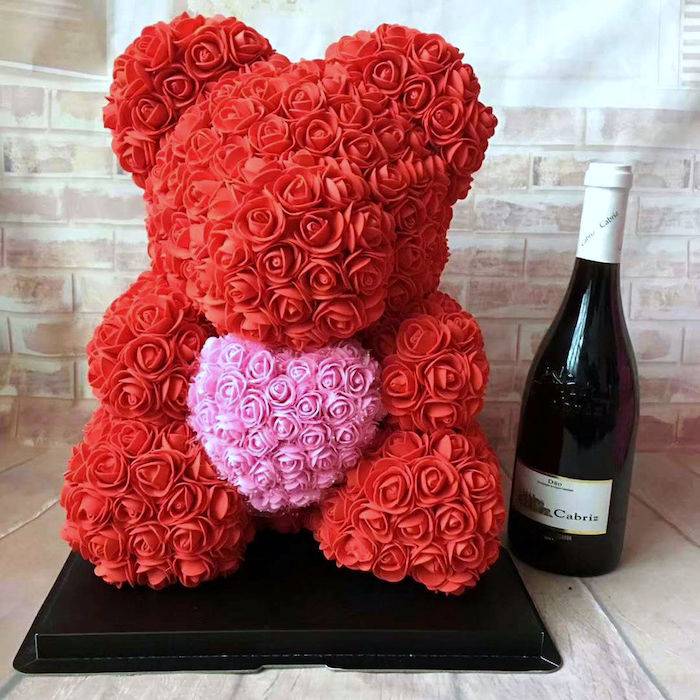 bear made of pink and red roses, holding a heart, valentine gift ideas, champagne bottle on the side
