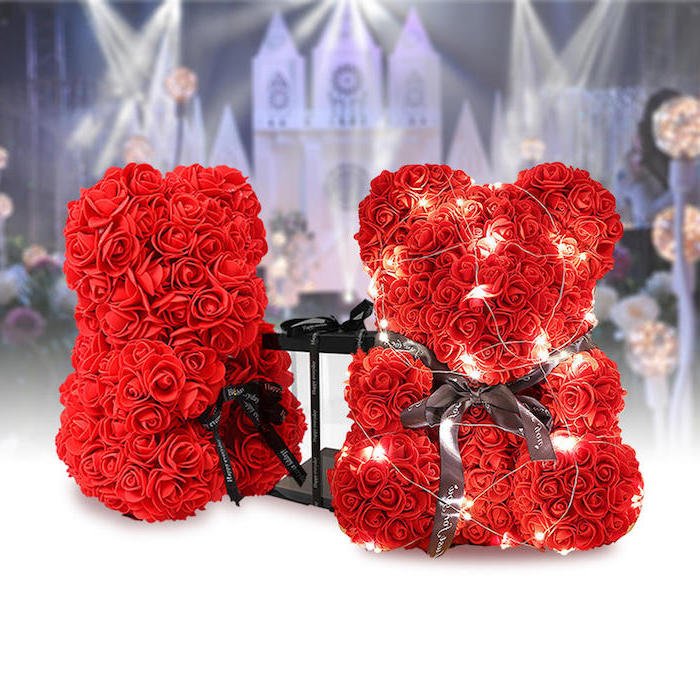 two bears made of red roses, wrapped with black satin bows and fairy lights, valentines decoration ideas, placed on white surface
