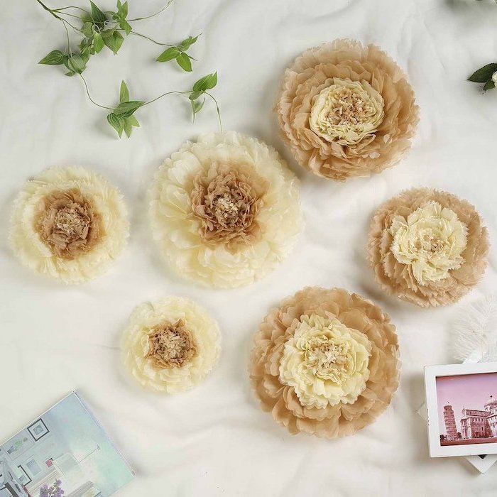 flowers made of different shades of beige tissue paper, paper flower templates, arranged on a white surface