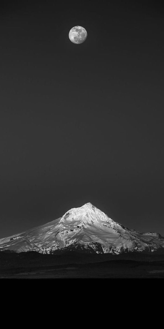 aesthetic wallpaper, black and white photo of a snowy mountain, full moon in a black sky, mountain landscape