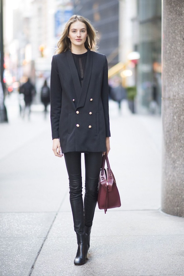 valentines dress, blonde woman walking on sidewalk, wearing black pants and top, black blazer and boots