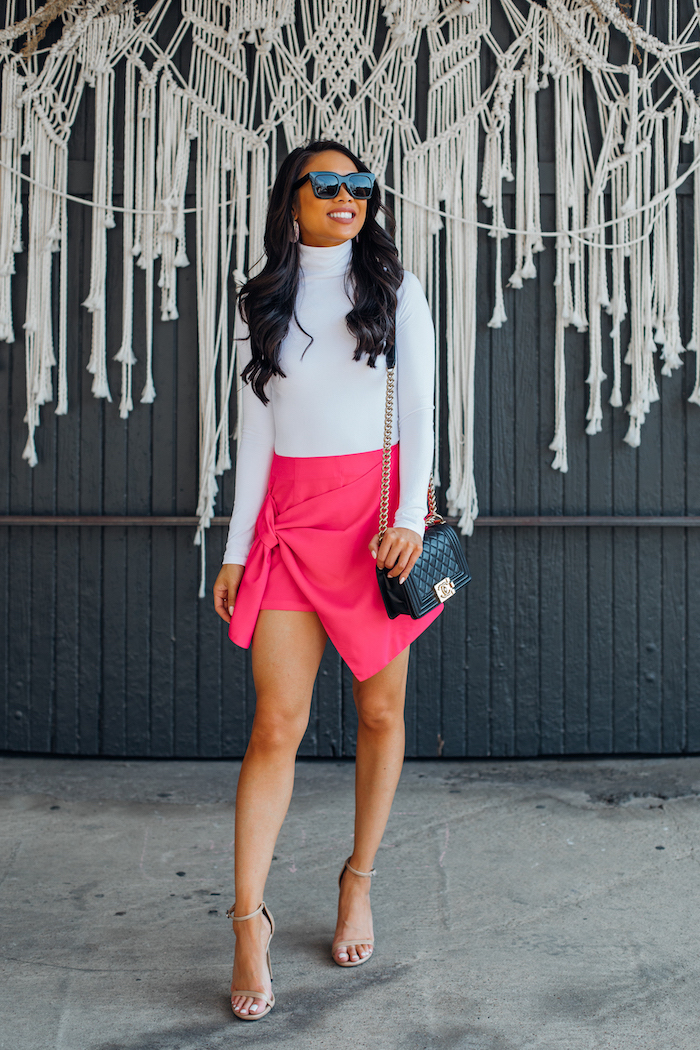 valentines day outfits, woman with black hair, wearing white polo blouse, pink short skirt, nude heels and black bag