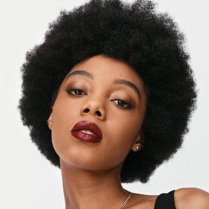 woman with curly black hair, how to apply eyeshadow, wearing nude eyeshadow colors, dark red lipstick