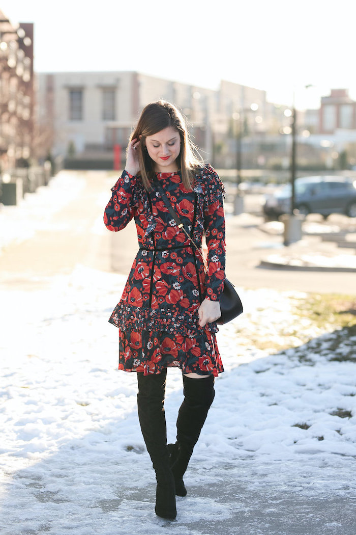 woman wearing red and black floral dress, knee high black velvet boots, valentines day outfits, standing in the snow