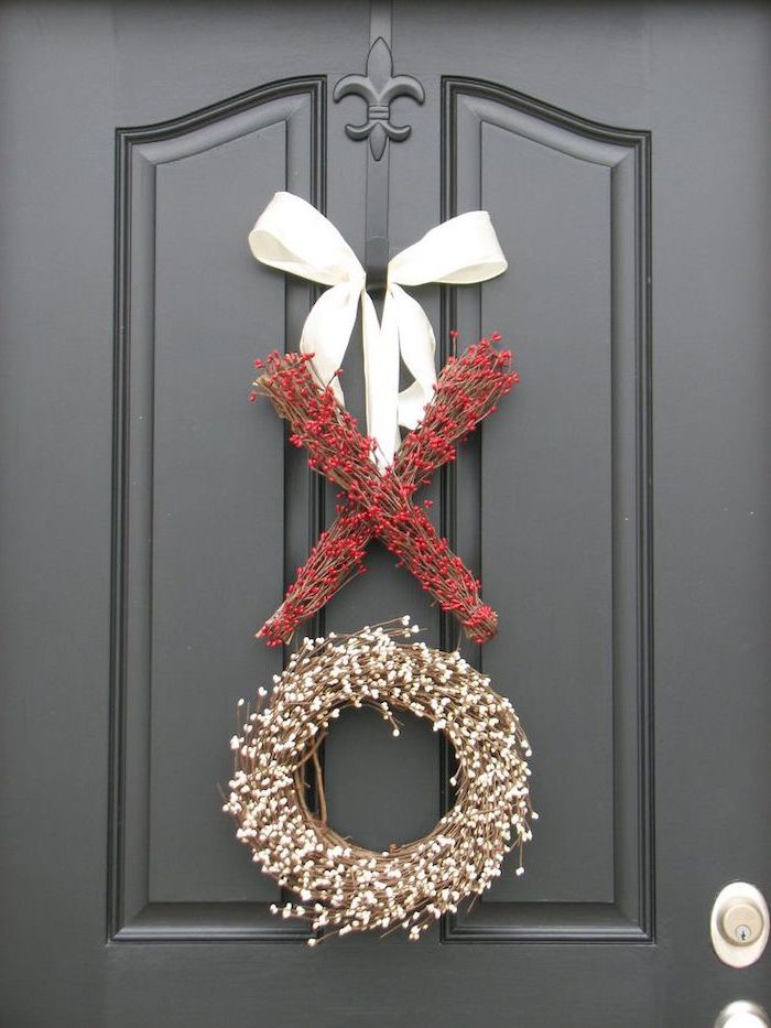 xo garlands and wreaths made with twigs and faux berries, hanging with white satin bow on black door, valentines decoration ideas