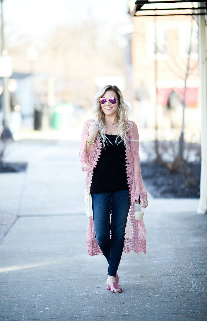 blonde woman wearing jeans, black top and pink kimono, holding a coffee cup, walking on sidewalk, valentines day dresses
